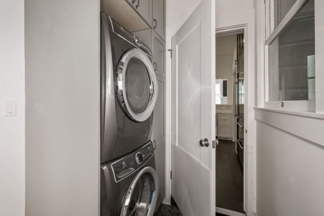 Laundry room developed as part of flat remodel and reconfiguration